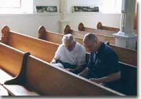 Caretaker Ben Polpelka and Father Alan Oakes review history of Praha church.