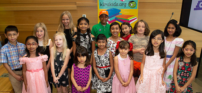 Winners of the KLRU Kids Writers Contest read their stories at the Central Library